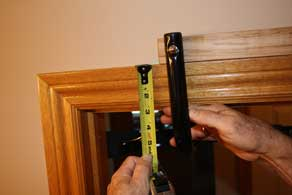 Measure the width of your trim overhead.