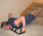 The Atlas push up bar using wide grip on two steps